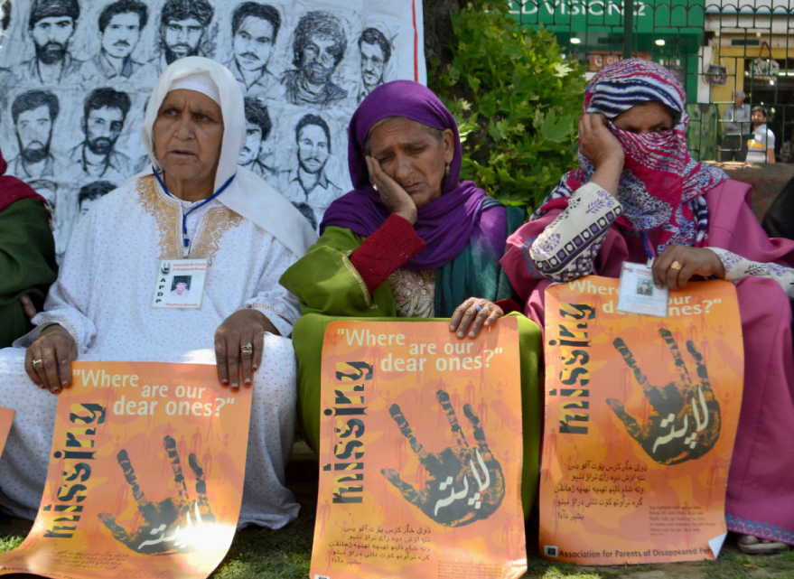 Relatives of disappeared Kashmiris participate during sit-in protest organized by the Association of Parents of Disappeared Persons (APDP) in Srinagar.